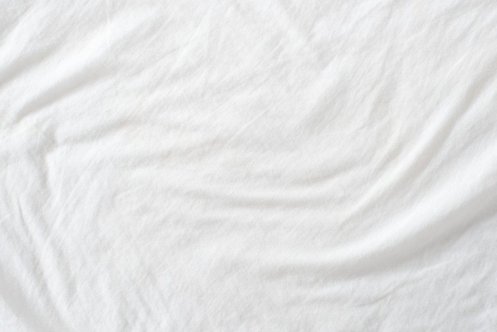 crumpled white bed sheet