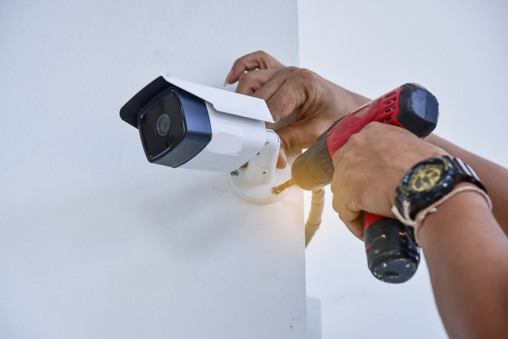 Person installing a security camera