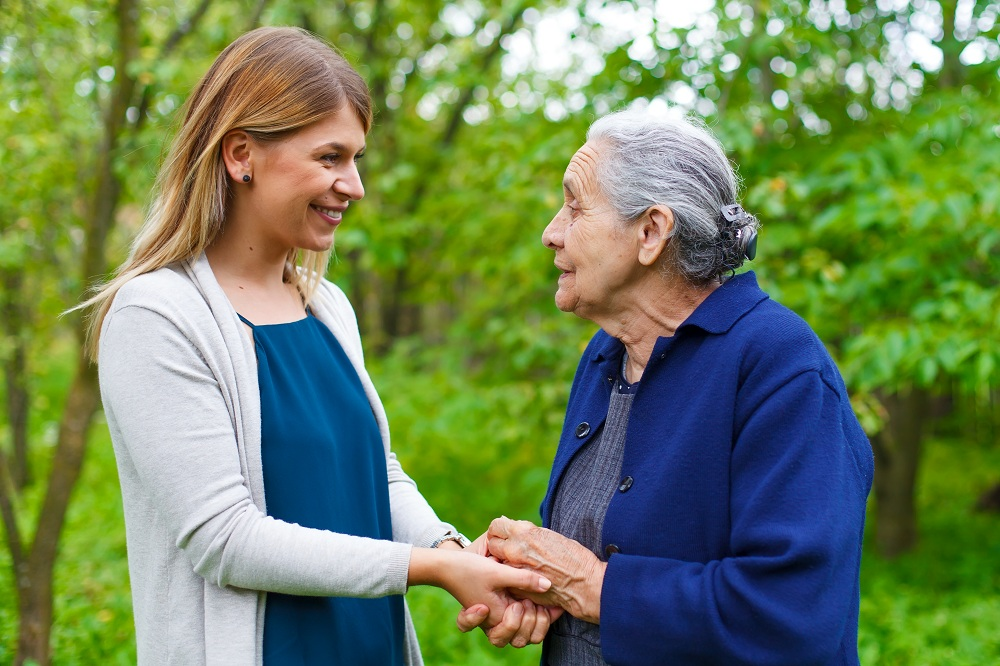 helping a senior woman