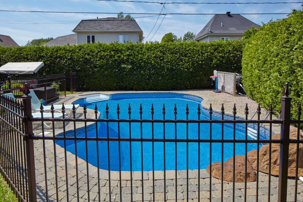 moder swimming pool with fence