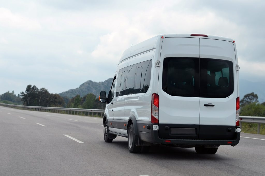 White sprinter van in the highway