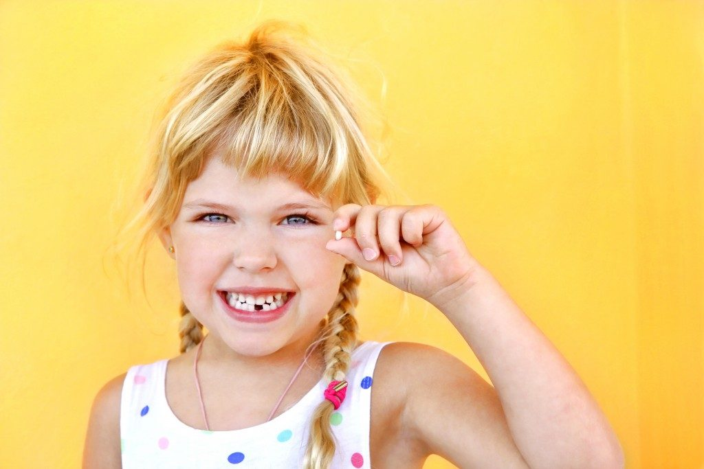 smiling girl with a lost tooth
