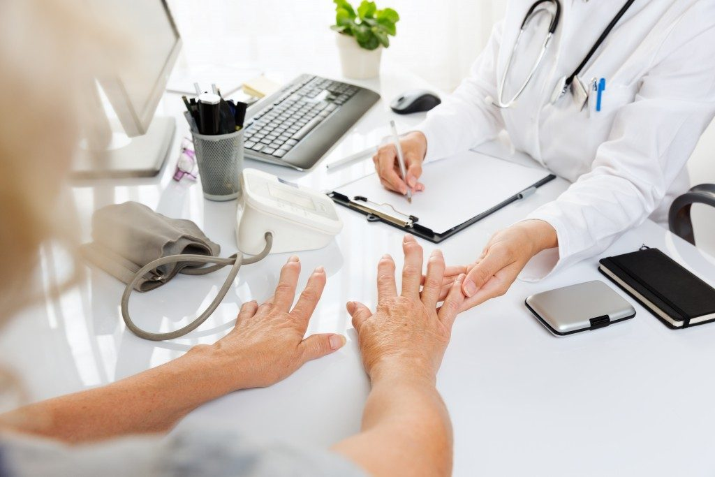Doctor checking the patient's hand