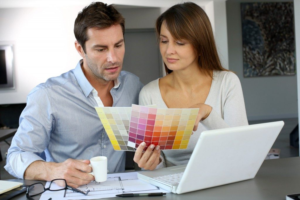 couple holding color chart