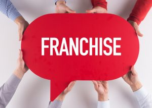 people holding red franchise speech bubble