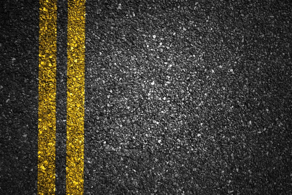 asphalt with yellow stripes