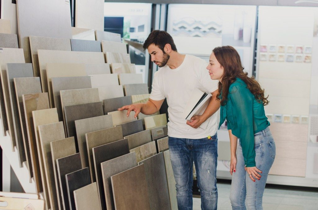 Couple looking at display tiles