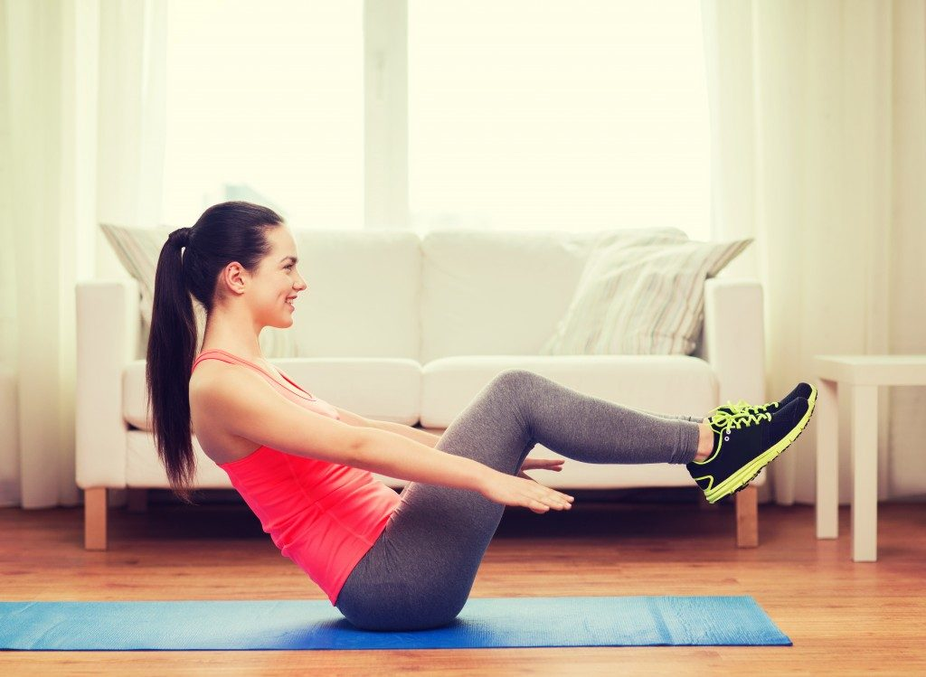 Fitness enthusiast doing floor exercise at home