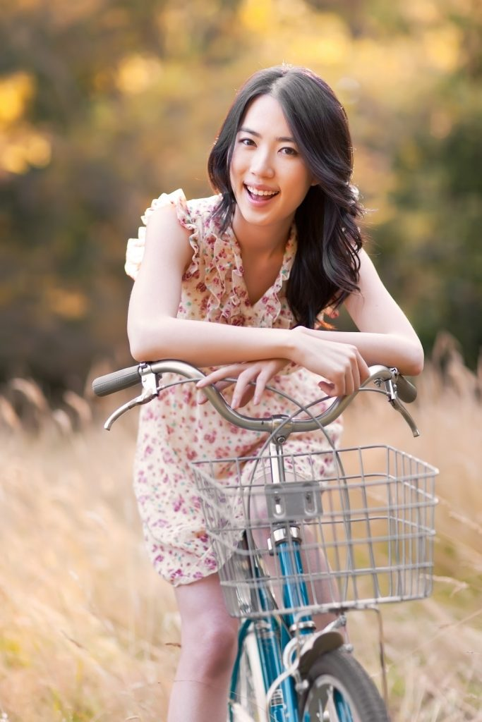 beautiful woman on her bike