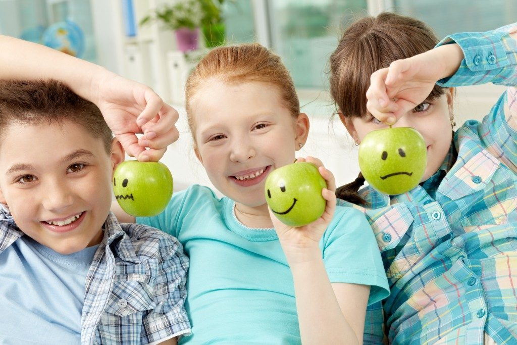 Children holding apples