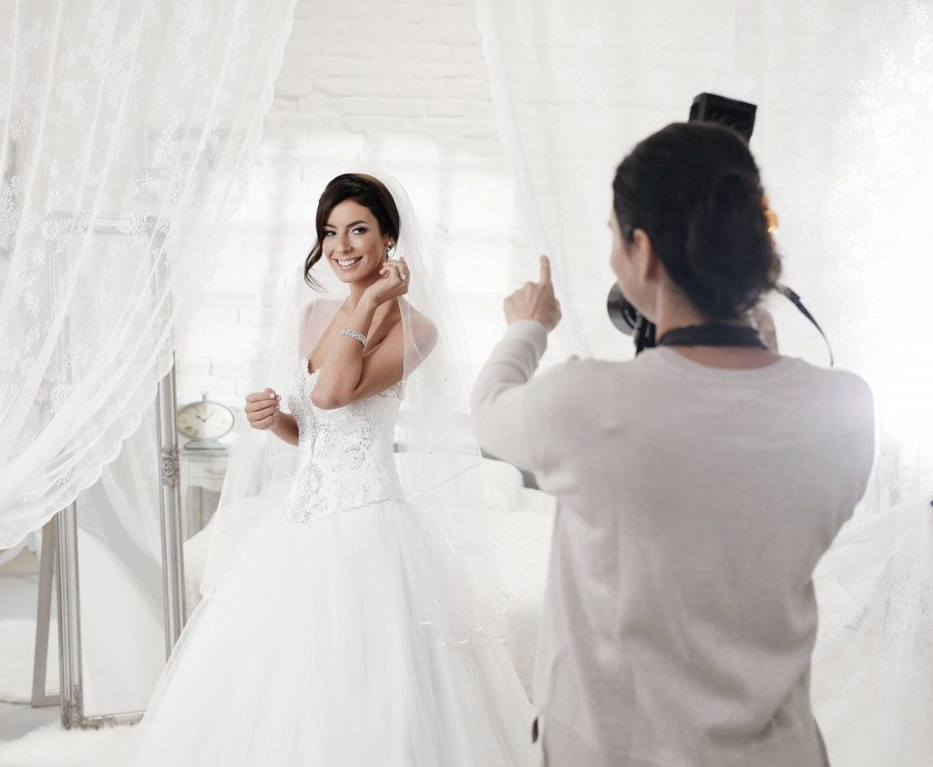 Taking a picture with your wedding dress