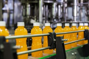bottle of juice being pack in the manufacturing house