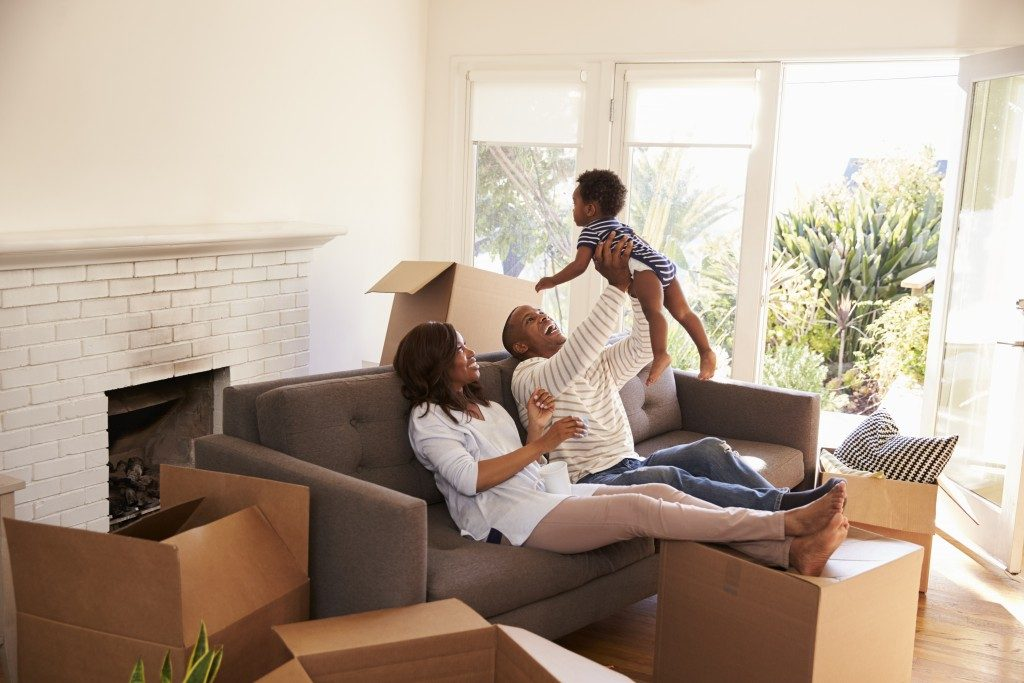 parents playing with their baby in new home