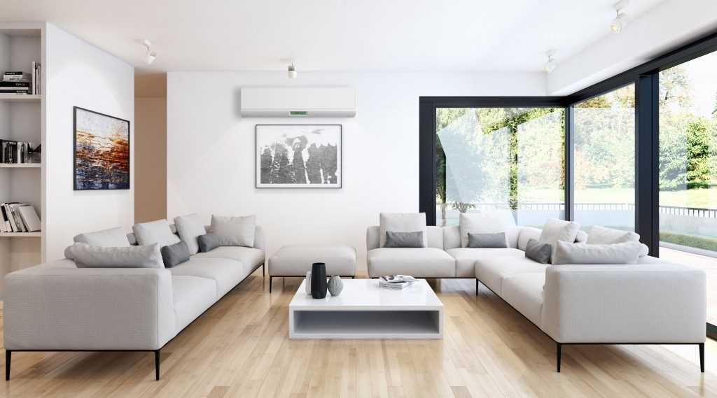 a modern living room design in white, black and brown color interiors