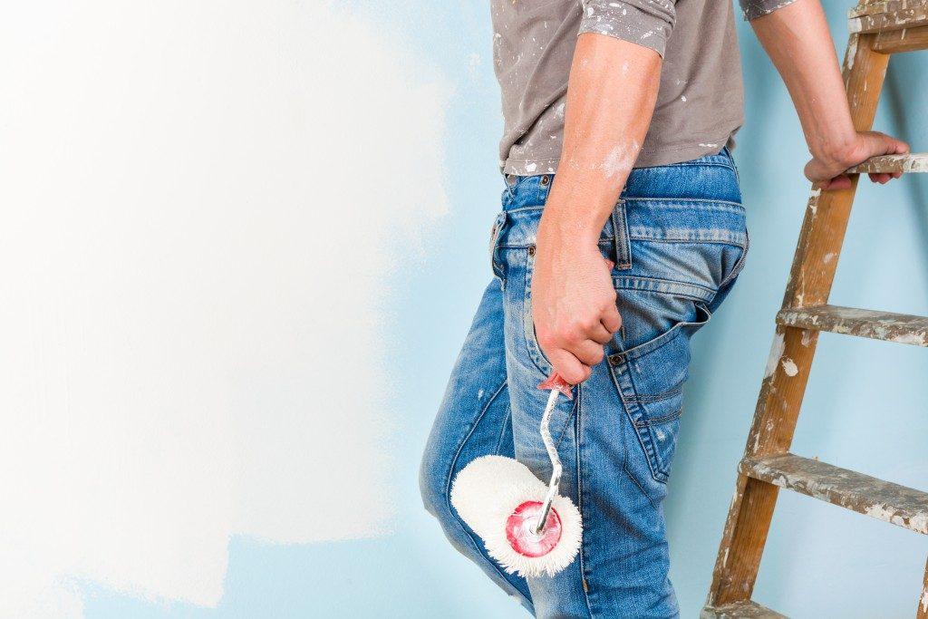 Man holding paint roller