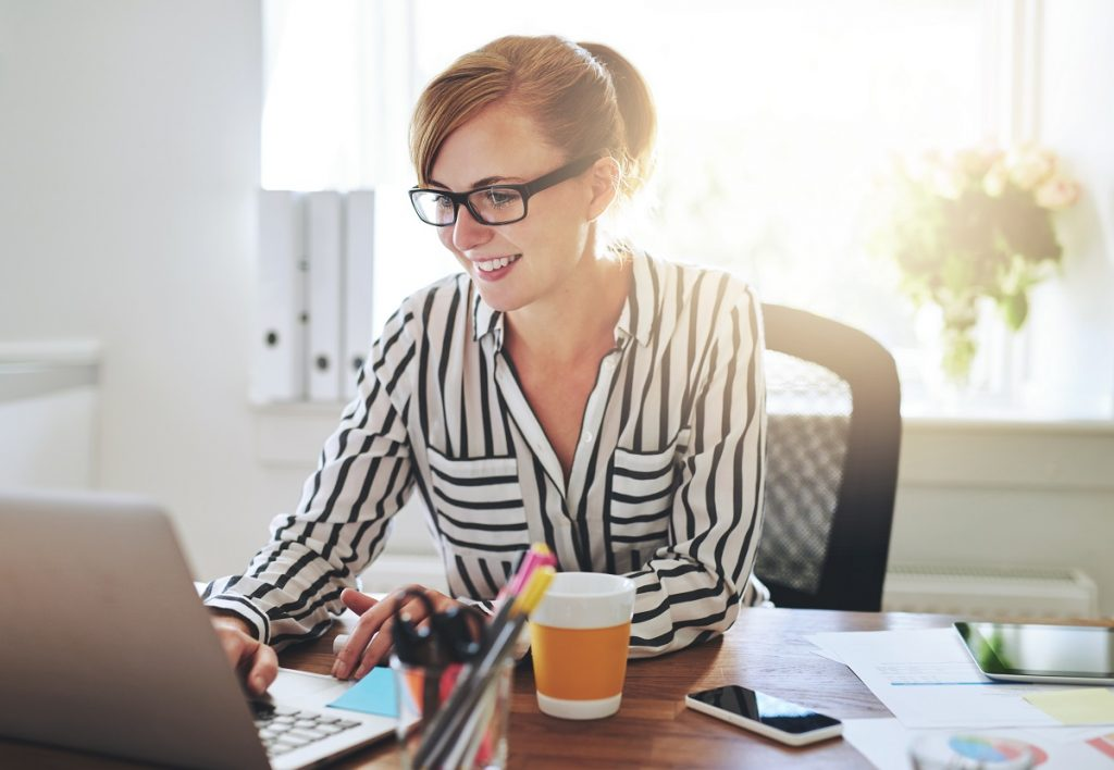 Woman working on marketing her newly started business