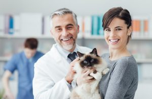 Vet with pet and owner
