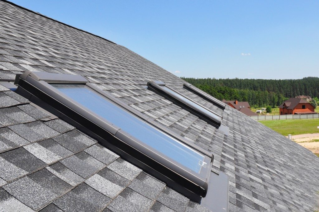 attic windows on gray roofing