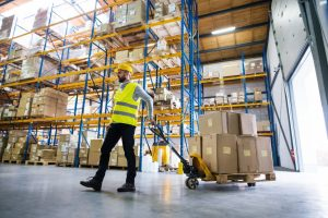 man inside the warehouse wearing safety hat and vest