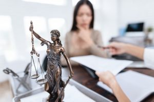 miniature of lady justice in a law office