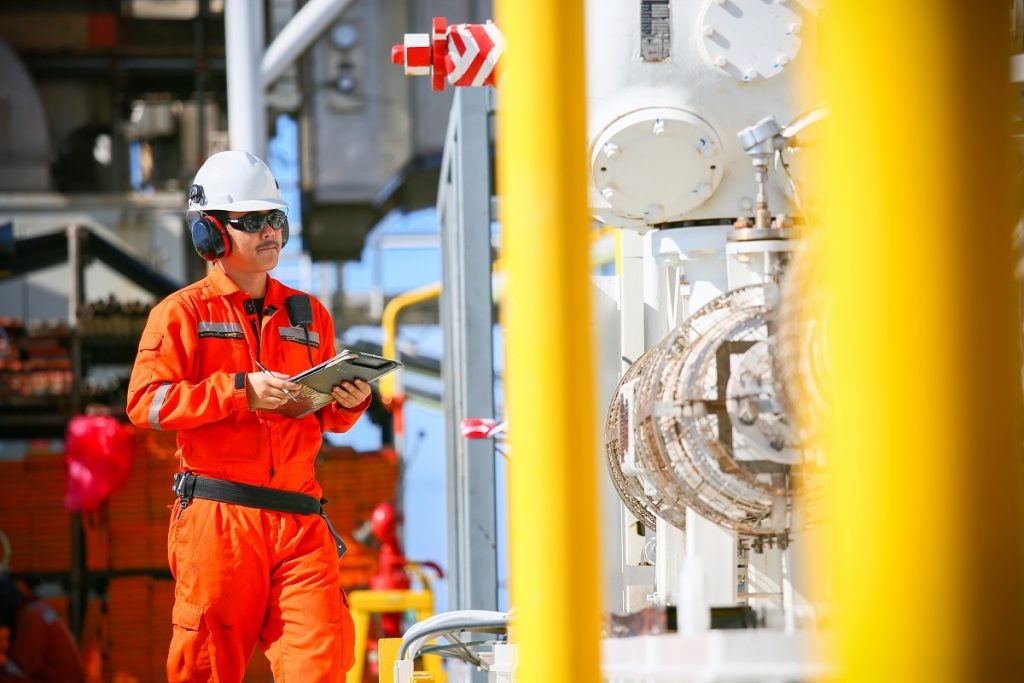 Man working at a refinery