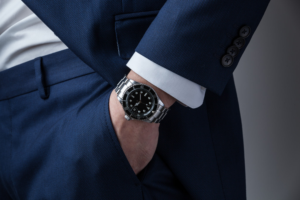 Hand in pocket with wrist watch