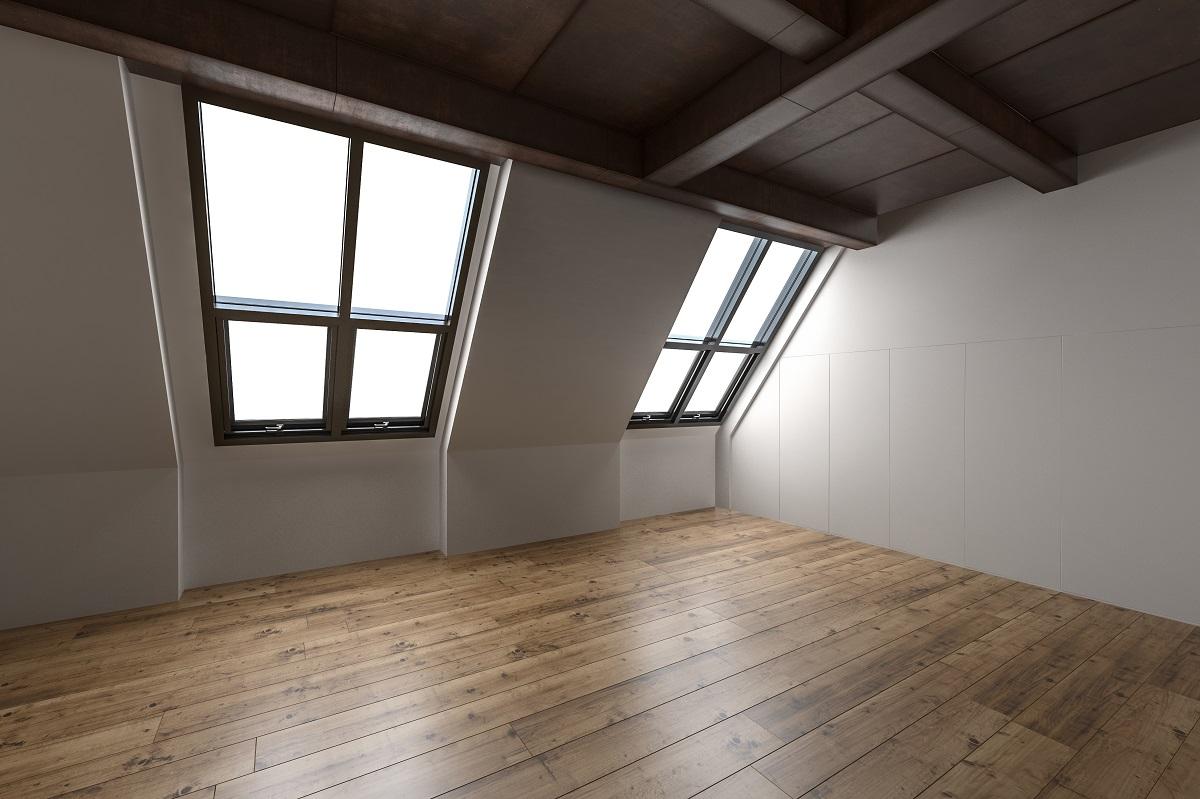 attic with hardwood floors