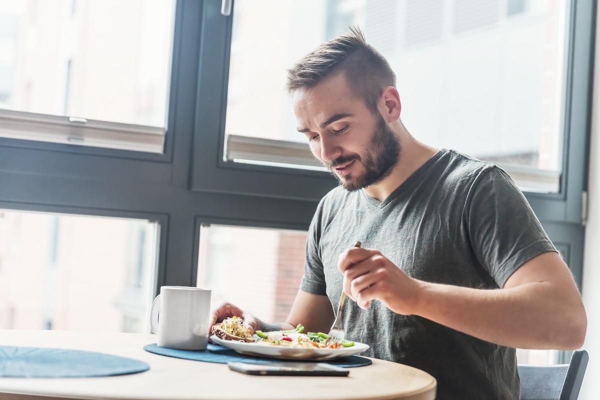 man eating his breakfast