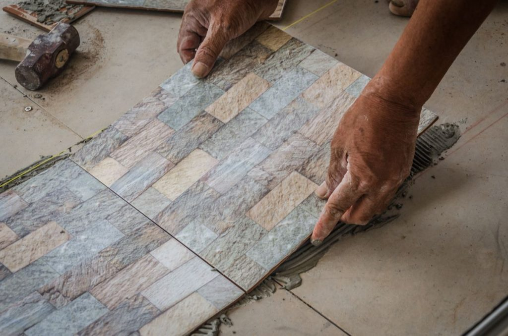 setting down tiles