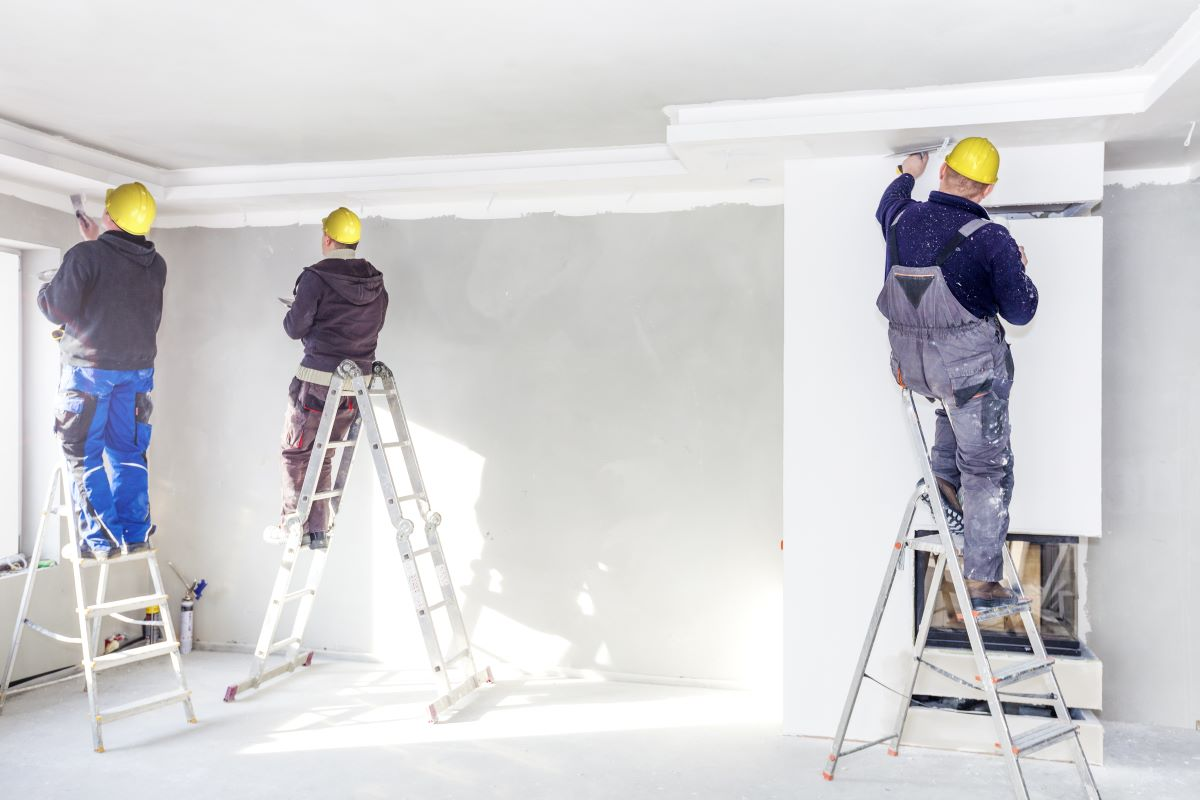 3 men painting a room