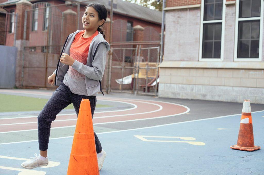 Kid running on a basketball court