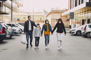 family outside wearing masks