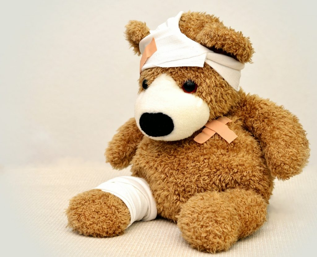 an injured teddy bear