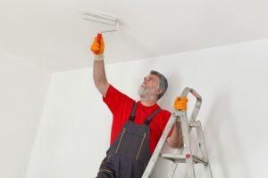 man repainting