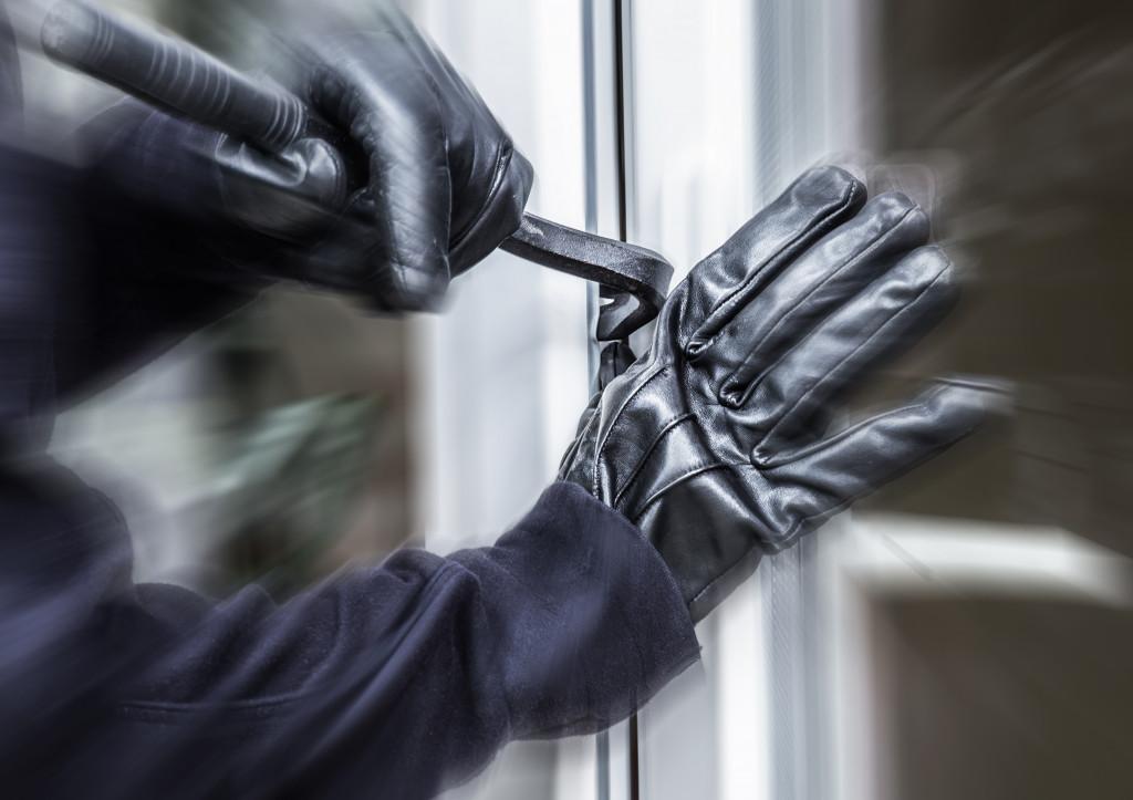 man breaking in
