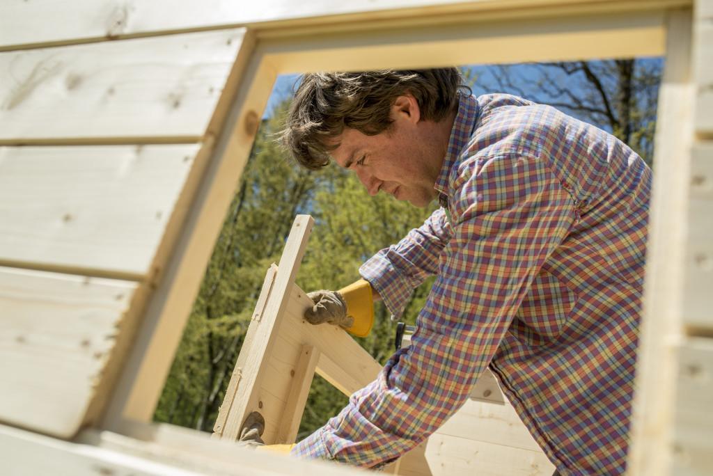 man building a treehouse