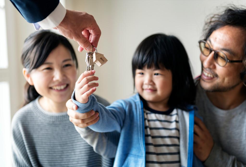 child receiving house keys