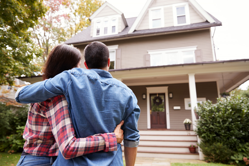 couple looking at their home