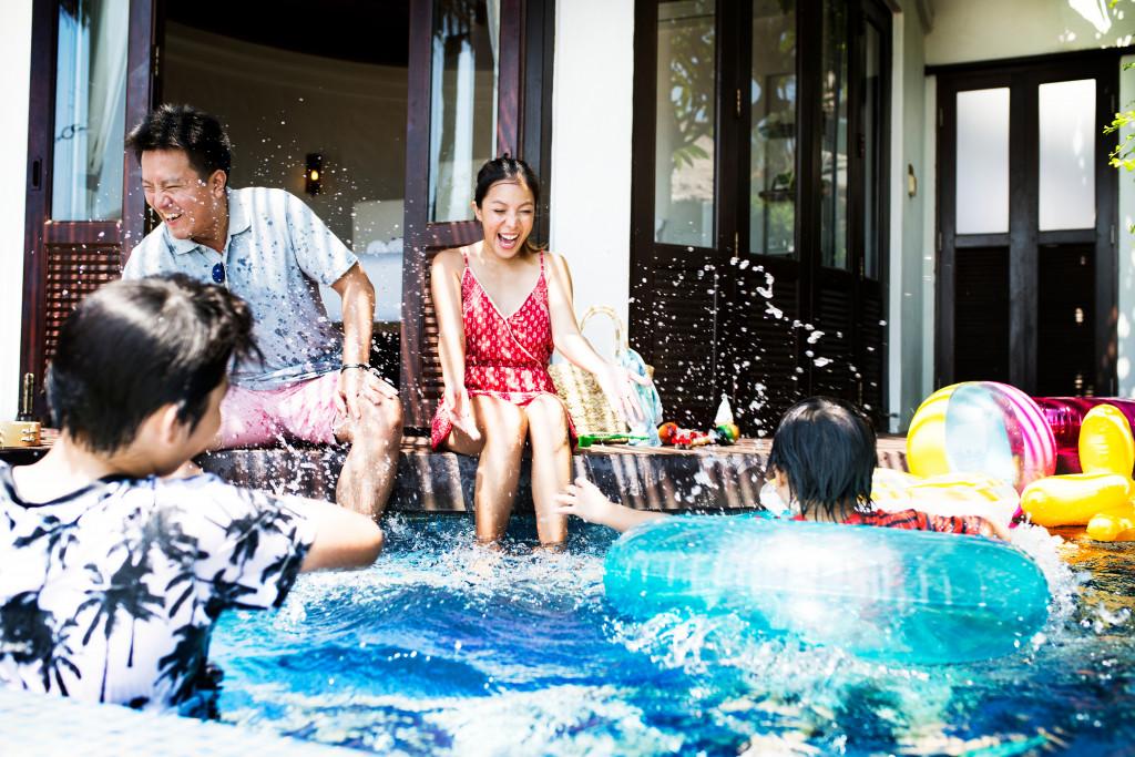 family having fun in a pool