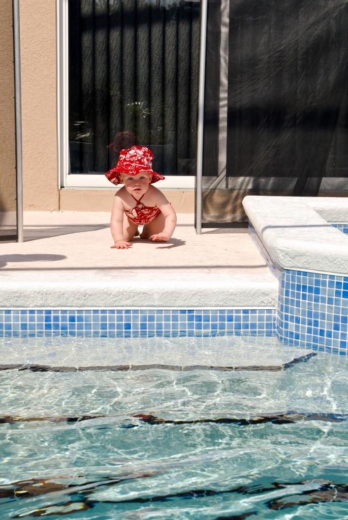 toddler near a pool